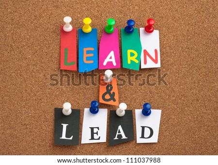 Learn & Lead pinned on cork bulletin board