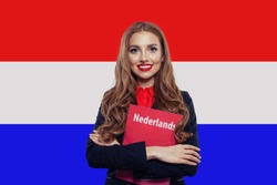 Learn netherlandish language. Happy woman student with book against the Netherlands flag background. Book with inscription neterlandish on netherlandish language