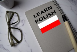 Learn Polish write on a book isolated on Office Desk