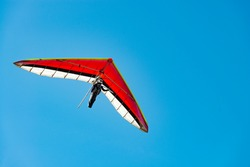 Learn to fly. Colorful paraglider wing against blue sky.
