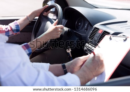 Learner driver student driving car with instructor #1314686096