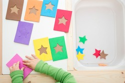 Learning colors. Matching game to find card for each star. 5 minute crafts, easy game ideas. Montessori methodology tool for focus on, concentration, speech therapy and fine motor skills.