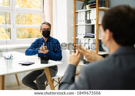 Learning Deaf People Language Sign With Face Mask Foto stock ©