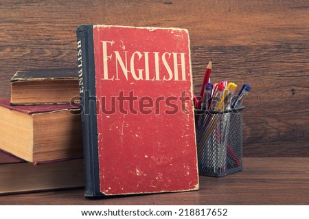 learning english concept. book on a wooden background