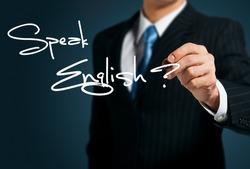 Learning English. Man writes on the screen Speak