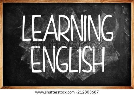 Learning English title on Language School Blackboard. Education concept.