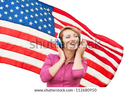 Learning language � American English (blond young woman with american flag, isolated)