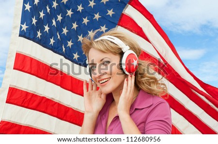 Learning language � American English (blond young woman with headphones)