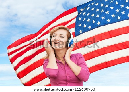 Learning language � American English (blond young woman with headphones, outdoor)