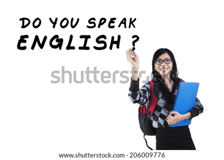 Learning language concept. Female student write Do You Speak English?