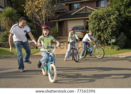 Learning to ride her bike