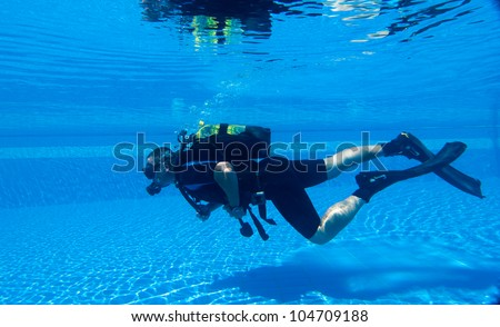 Learning To Scuba Dive In A Swimming Pool Stock Photo 104709188 Shutterstock