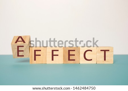 Learning to use proper grammar, Flipping one wooden cube to change the word Affect to Effect.