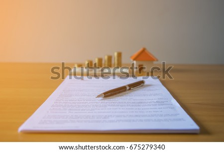Lease / Rental agreement document with keys and pen. Highlighted text