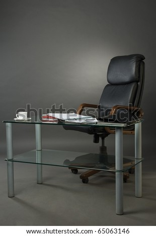 Leather armchairs and glass table