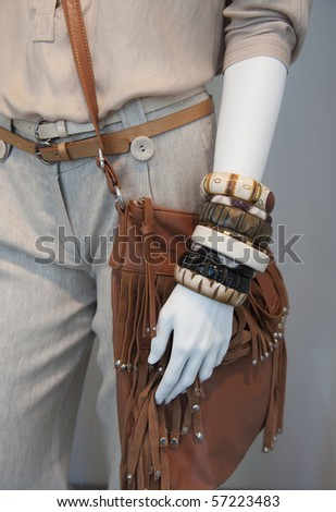 Leather bag,bracelets and belt on trousers