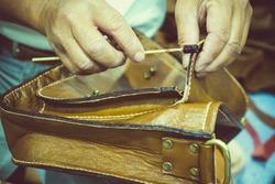 Leather bag maker.