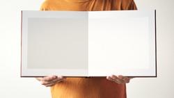 leather bound photo album in hand. Mock up photobook. design concept.