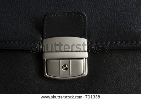 Leather briefcase buckle.