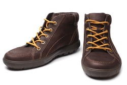 Leather brown boots on white background