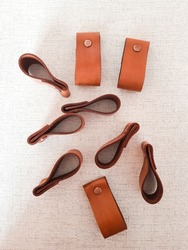Leather cabinet handles. DIY leather drawer pulls.