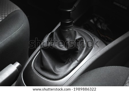 Leather casing of manual gearstick transmission inside of the black interior of car Stock photo ©