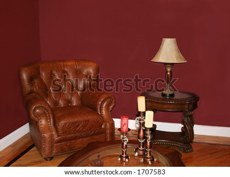 Leather chair and tables; blank wall