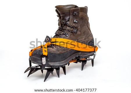 leather climbing boots with crampons, isolated on white background #404177377
