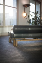 Leather couch with brass in an office