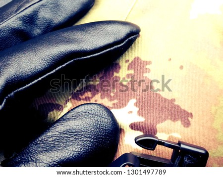 leather gloves and buckle. black, on camouflage (italian pattern)