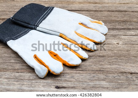 Leather gloves,Leather gloves on wood  background.