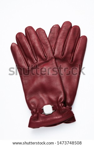 Leather gloves on a white background.