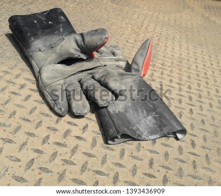 Leather gloves placed on the steel floor