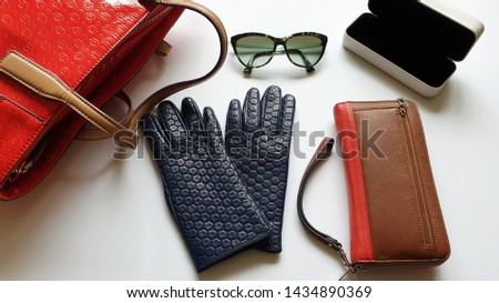 leather gloves red handbag black sunglasses purse on white background concept Women clothes accessories fashion luxury advertisement shopping