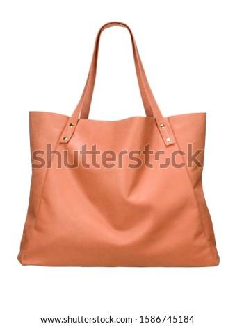 Leather handbag on white background