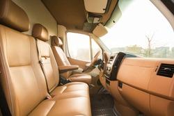 Leather interior of a minibus. luxury car interior. beige car interior