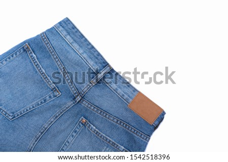 Leather jeans label sewed on jeans background Leather jeans label sewed on jeans background