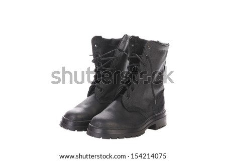 cb240e667e9 Old black army boots trampling egg. The… Stock Photo 432095215 ...