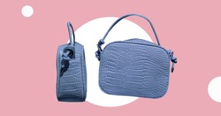Leather mock croc tote handbag isolated. Animal texture handbag. Woman elegant handbag with two handles in a showcase. Fashion women accessories. Fashion concept. Pattern