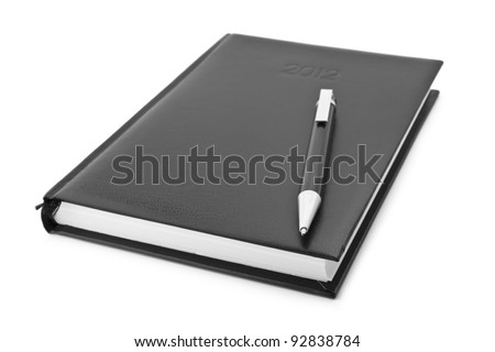 Leather notebook and pen isolated on the white background