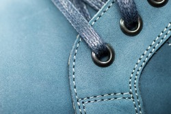 Leather (Nubuck) shoes, focus on details. Macro shot with shallow depth of field.