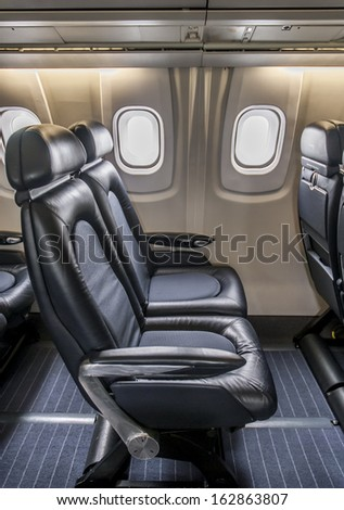 Leather seating inside cabin of a luxury jet Concorde.