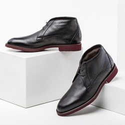 leather shoes for winter on a white box