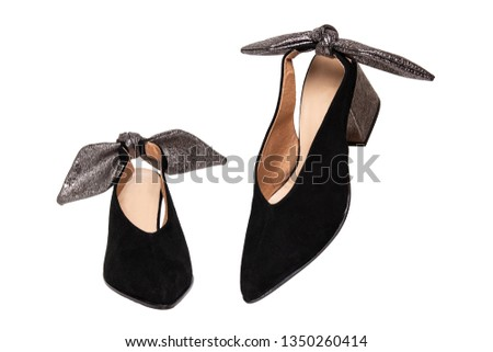e2b7e0336 Leather shoes isolated. A pair of elegant female suede shoes decorated with  silver bows isolated