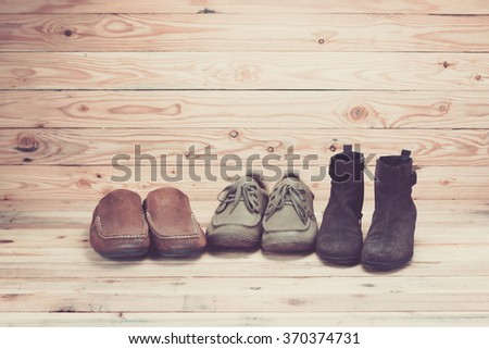 Leather shoes on wooden background #370374731