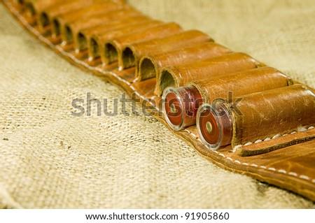 leather shotgun cartridge belt on hessian
