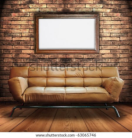 Leather Sofa on Wood Floor and Wood frame Sign in Brick Wall Room - stock photo