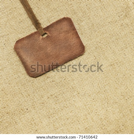 Leather tag on the background of fabric