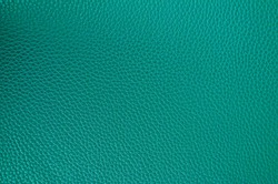 Leather texture close up. Aquamarine fashionable background, top view. Stylish wallpaper of snake skin. Rough surface of sea wave color.