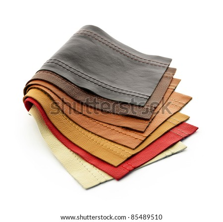 Leather upholstery samples with stitching in various colors isolated